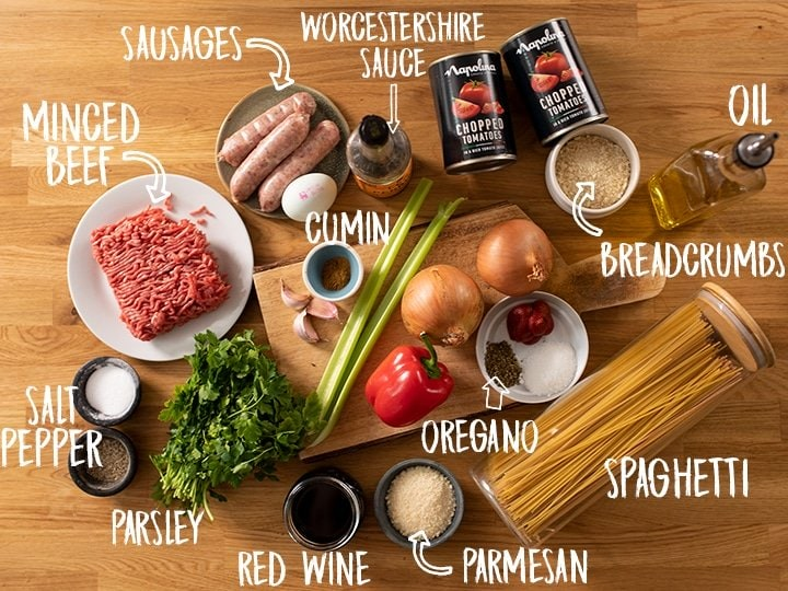Ingredients for Spaghetti and meatballs on a wooden table