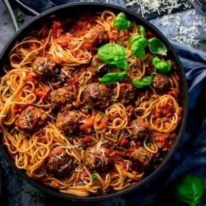 Square image of Spaghetti and meatballs in a pan