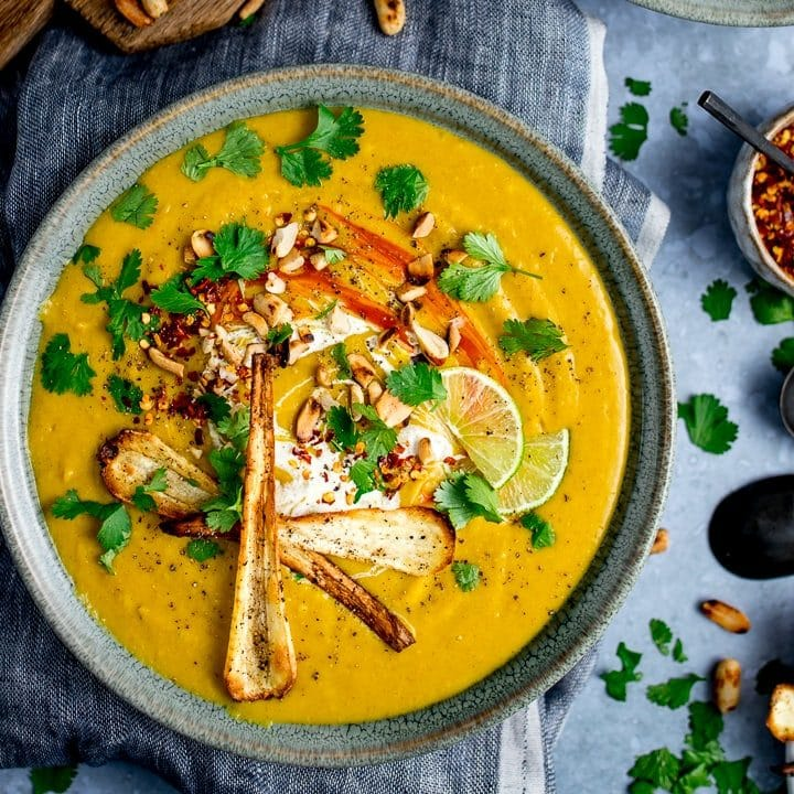 Spicy parsnip and sweet potato soup with parsnip crisps and coriander toppings