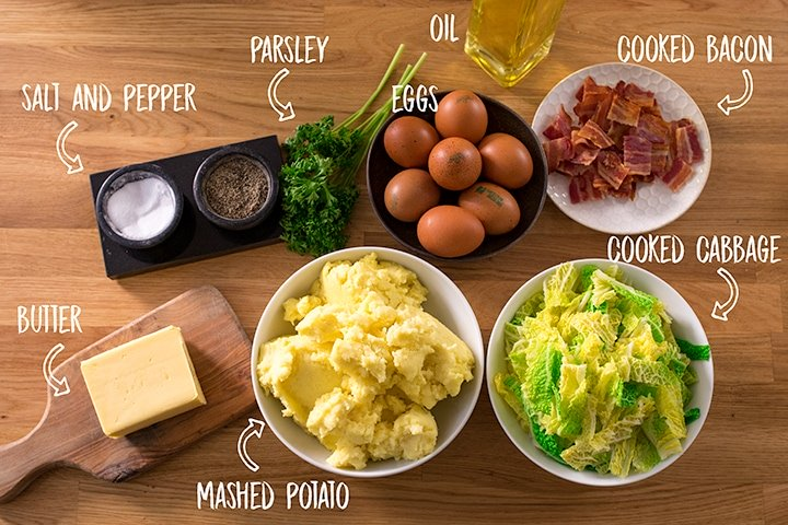Ingredients for bubble and squeak on a wooden table