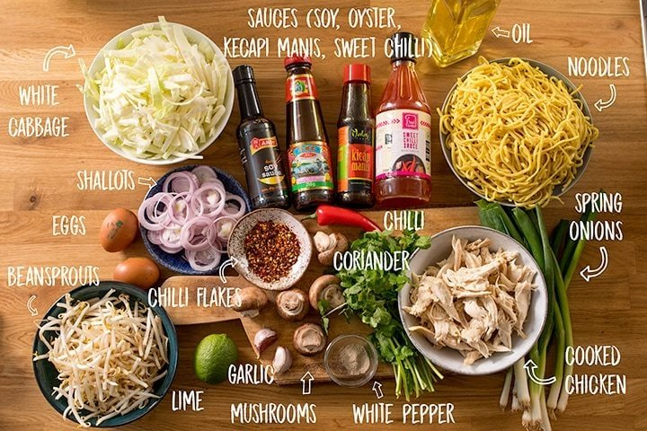 Ingredients for mee goreng on a wooden table