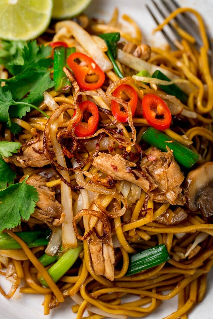 Close up of a plate of mee goreng with chillies on top