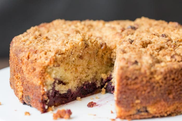 Close up of a Cherry Crumble Cake with a slice taken out