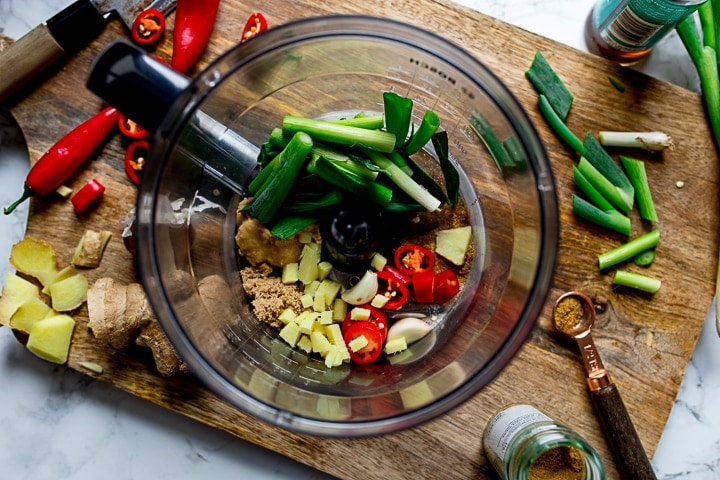 fresh ginger, spring onions, chillies ans spices ina food processor