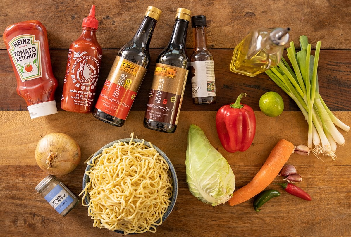 Ingredients for chilli lime noodles on a wooden table.