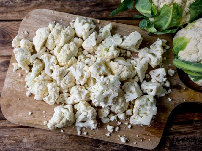 Chopped cauliflower on a chopping board