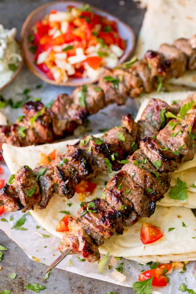 Marinated succulent lamb, juicy and beautifully charred. These Greek Lamb Souvlaki Kebabs are so tasty. Cook them on the BBQ for added flavour! #souvlaki #lambkebabs #lambsouvlaki #greekfood #bbq #bbqfood #kebabs #kabob