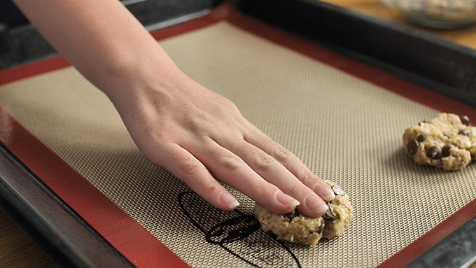 Hand flattening banana oat cookie dough, before they go in the oven