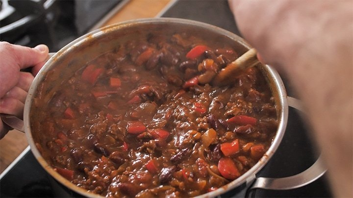 chilli con carne simmering in a pan