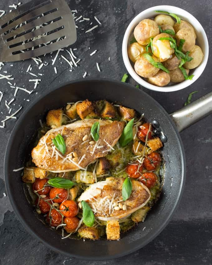 Creamy pesto chicken with roasted tomatoes and croutons - A vibrant, one-pot dish, full of flavour. Ready in less than 30 mins.