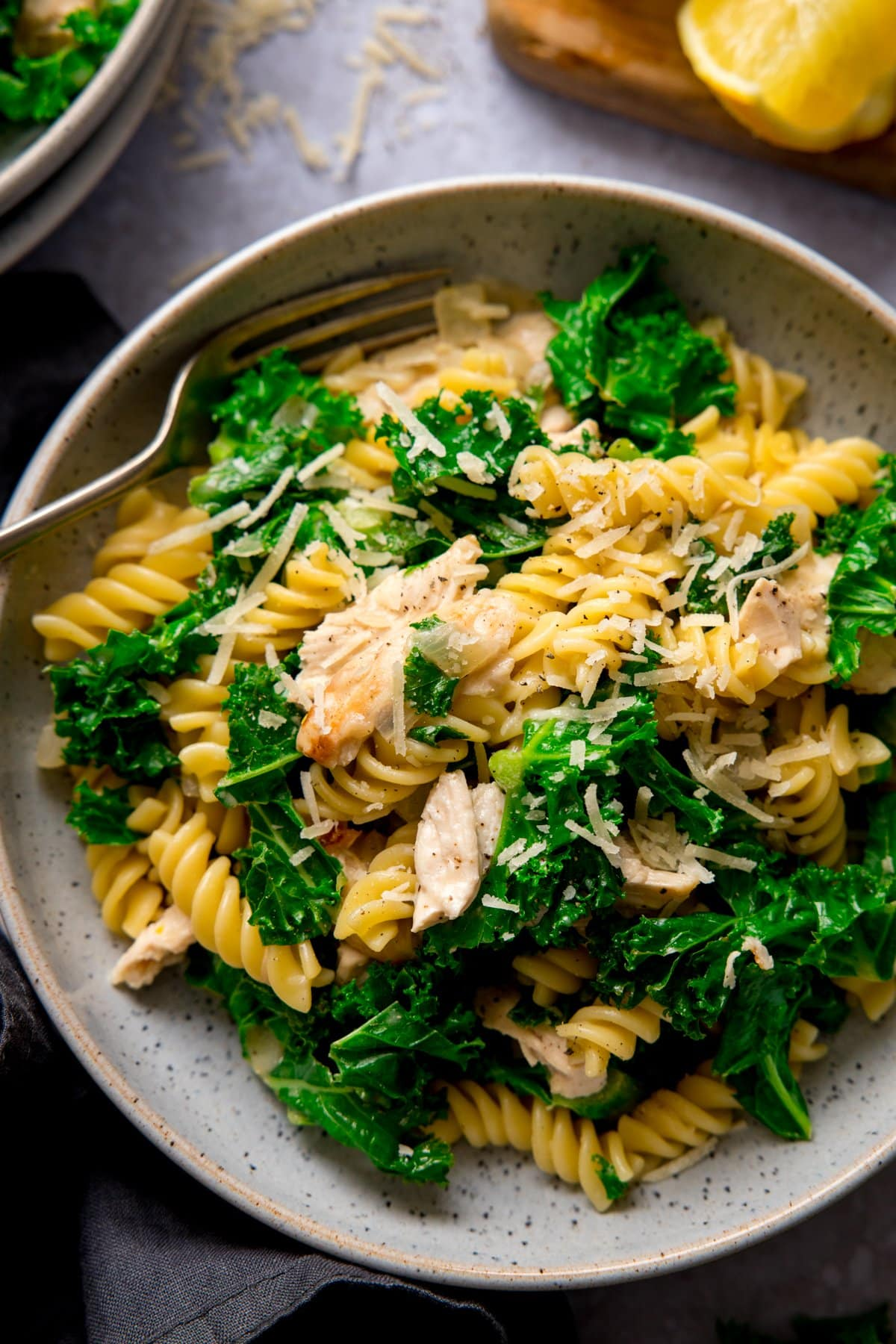Overhead shot of a bowl of garlic chicken pasta and kale