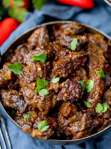 Beef Rendang - Slow-cooked fall apart spicy beef with a touch of heat.