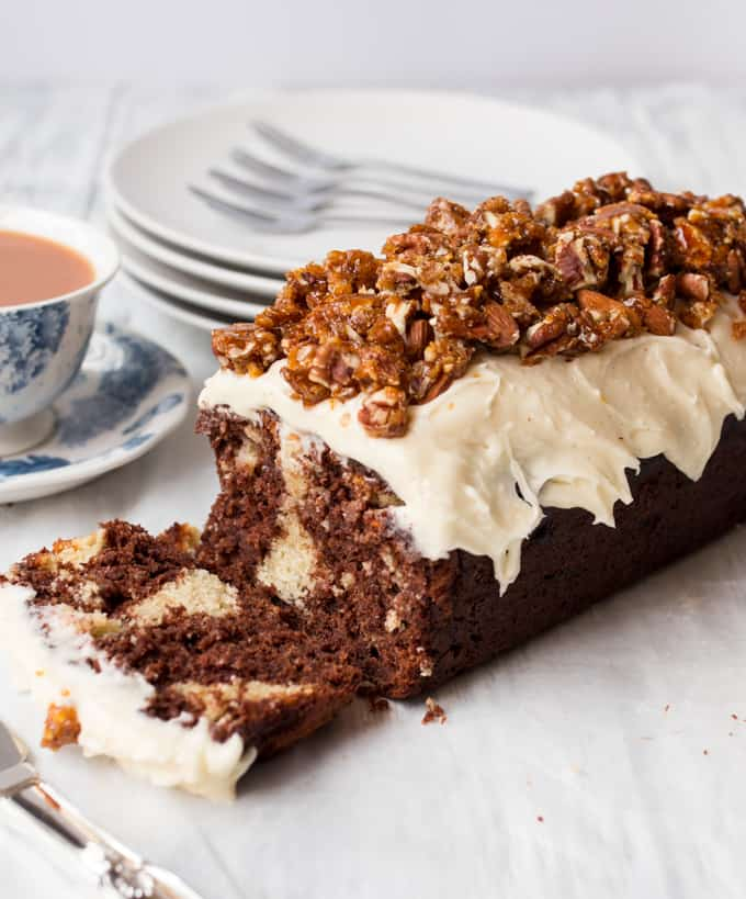 Chocolate almond banana bread - Rich and moist chocolate banana bread, dotted with swirls of frangipane and topped with almond frosting and candied nuts.
