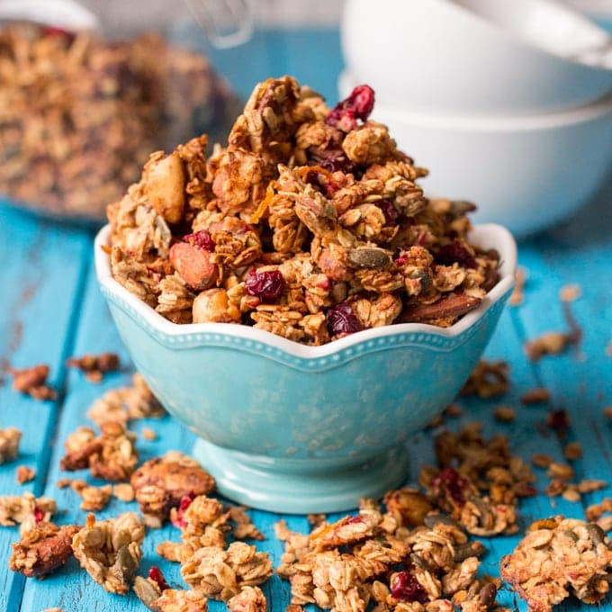 A blue bowl brimmed full of Cranberry nut granola