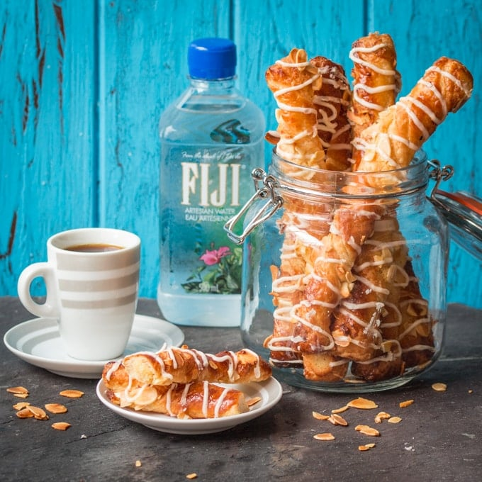 Croissant twists - flaky croissant pastry, filled with almond paste and drizzled with creamy almond frosting.