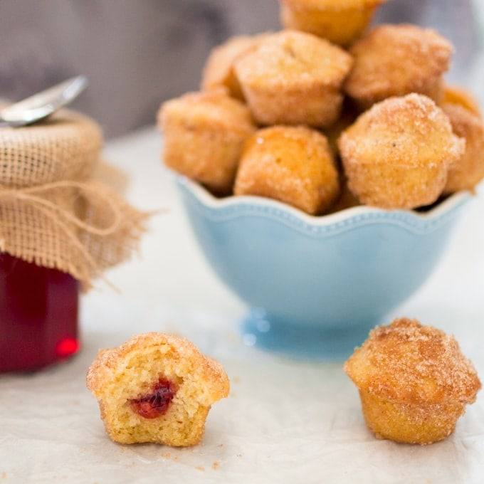 Xmas Duffins - A baked mini donut-muffin filled with homemade mulled cranberry jelly and dusted in cinnamon sugar.