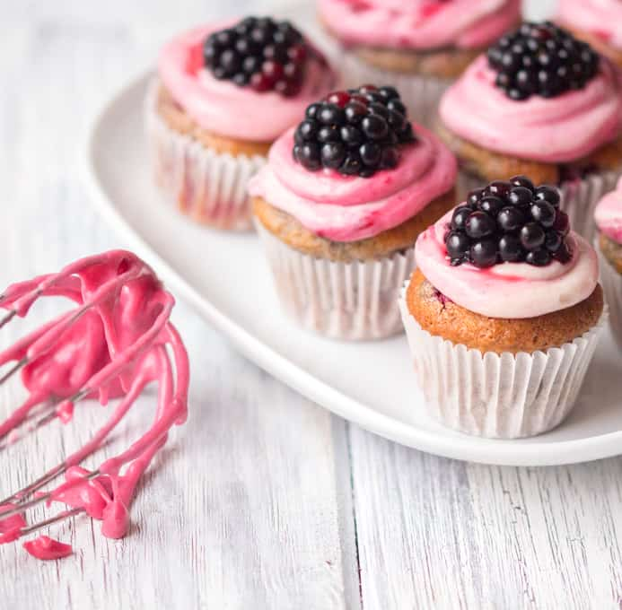 Blackberry Spice Bites - Sweet little muffin bites made with mixed spices and topped with a ginger and blackberry frosting.