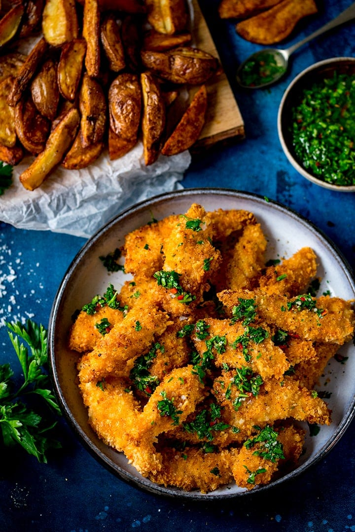 Crispy Chicken Strips with Chimichurri on a blue background
