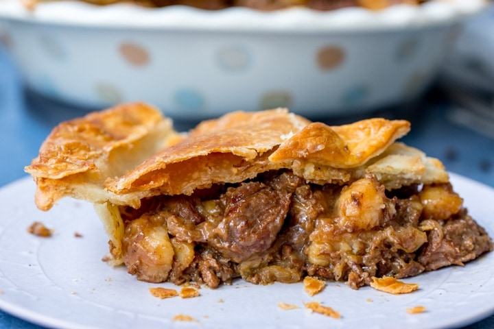 Wide image of slice of steak and potato pie