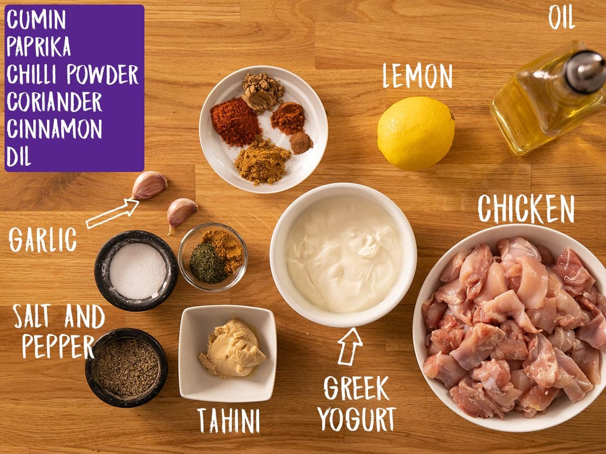 Ingredients for Chicken Shawarma on a wooden table