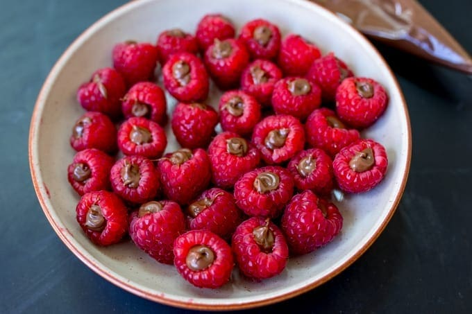 Raspberries filled with Nutella in a bowl