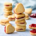 Stack of heart shaped valentine shortbread cookies on a light blue background