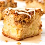 A soft sponge base with a hint of cinnamon and chunks of juicy apple, topped off with a crunchy streusel and vanilla drizzle