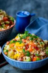 Fried rice in a blue bowl with blue background