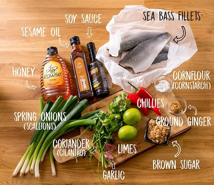Ingredients for sticky Asian sea bass on a wooden table