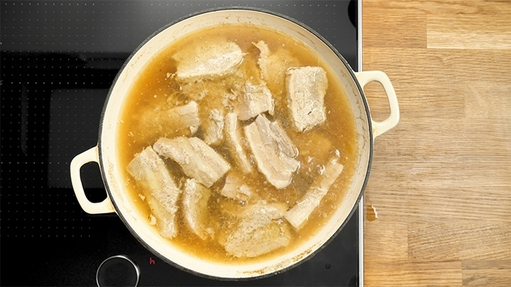 Slow cooked pork belly in broth