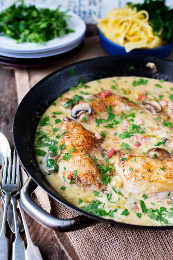 Coq au Riesling - Tender chicken cooked in a white wine sauce with mushrooms and cream.