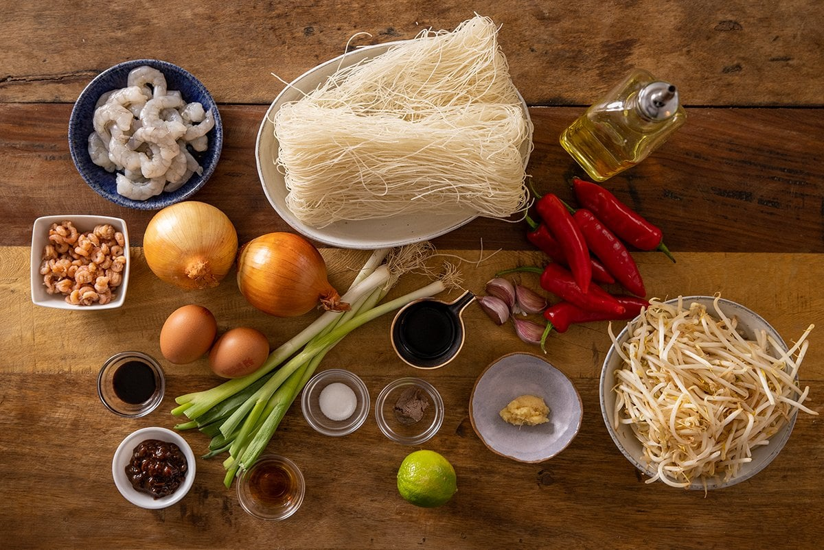 Ingredients for Mee Siam on a wooden table.