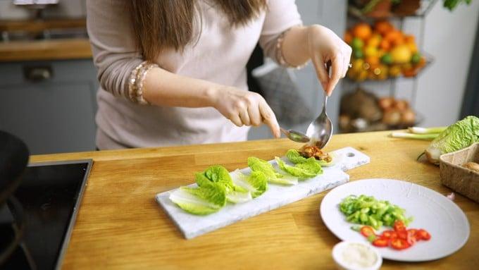Spoon asian chicken into lettuce wraps