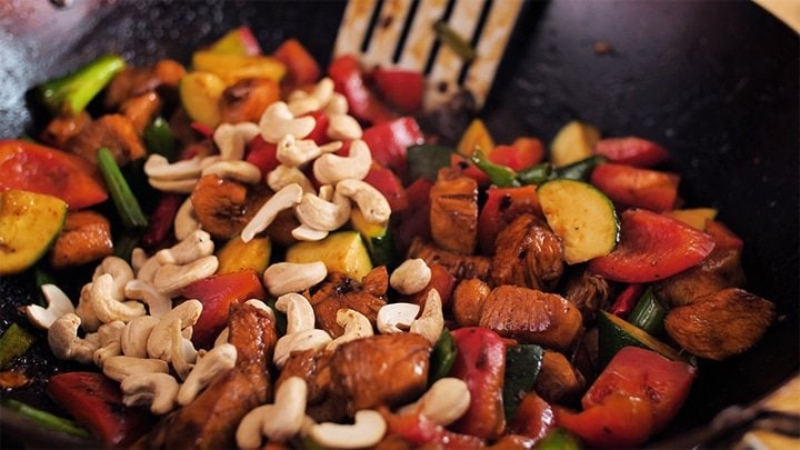 Close up of kung pao chicken in wok