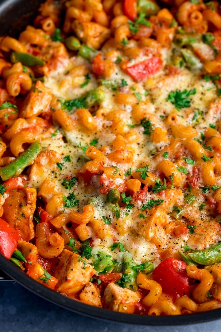 Close up of cheesy tomato chicken pasta in a pan