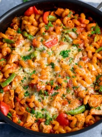 Close up of pan of cheesy chicken pasta