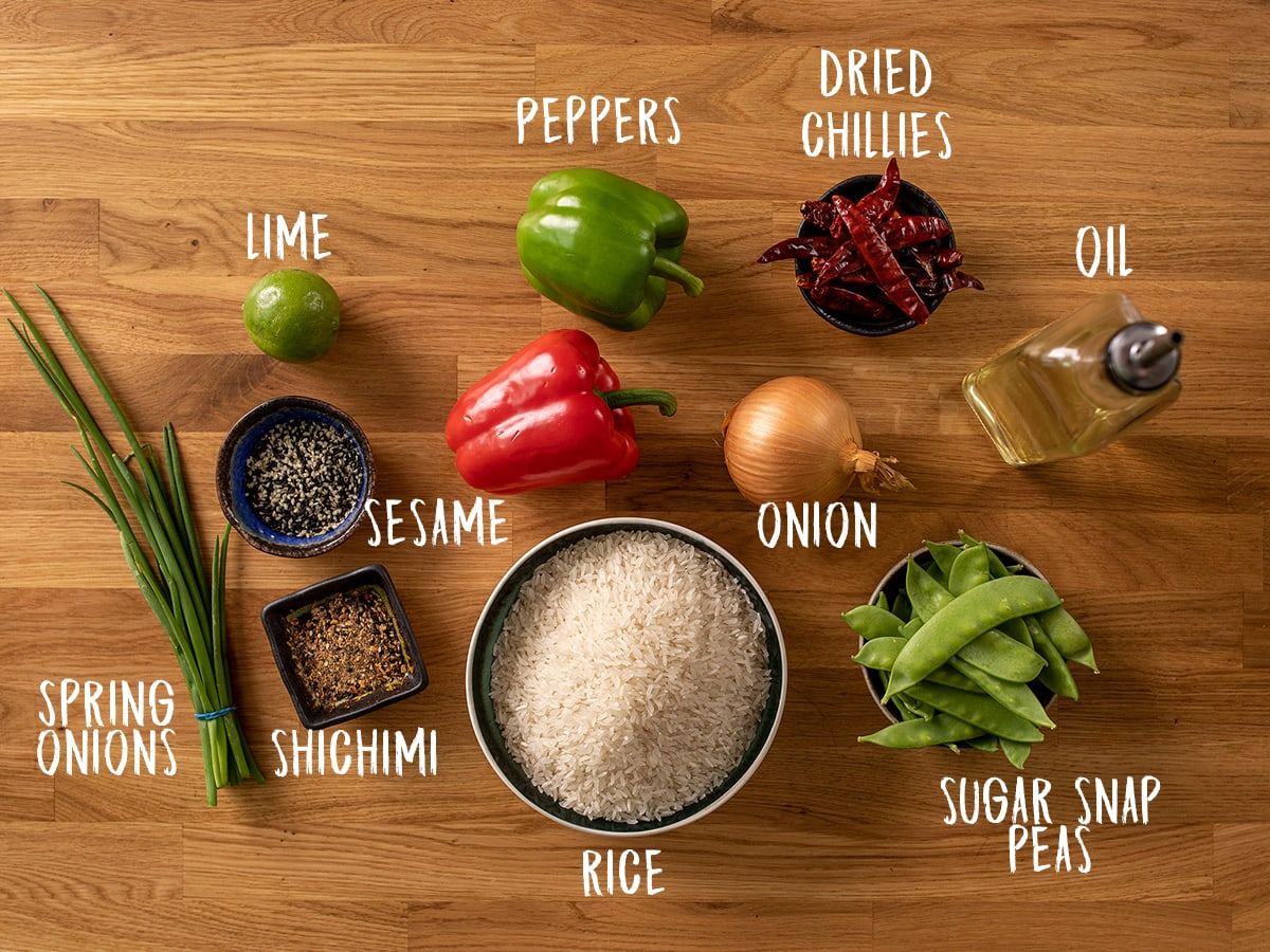 Firecracker stir fry and rice ingredients on a wooden background