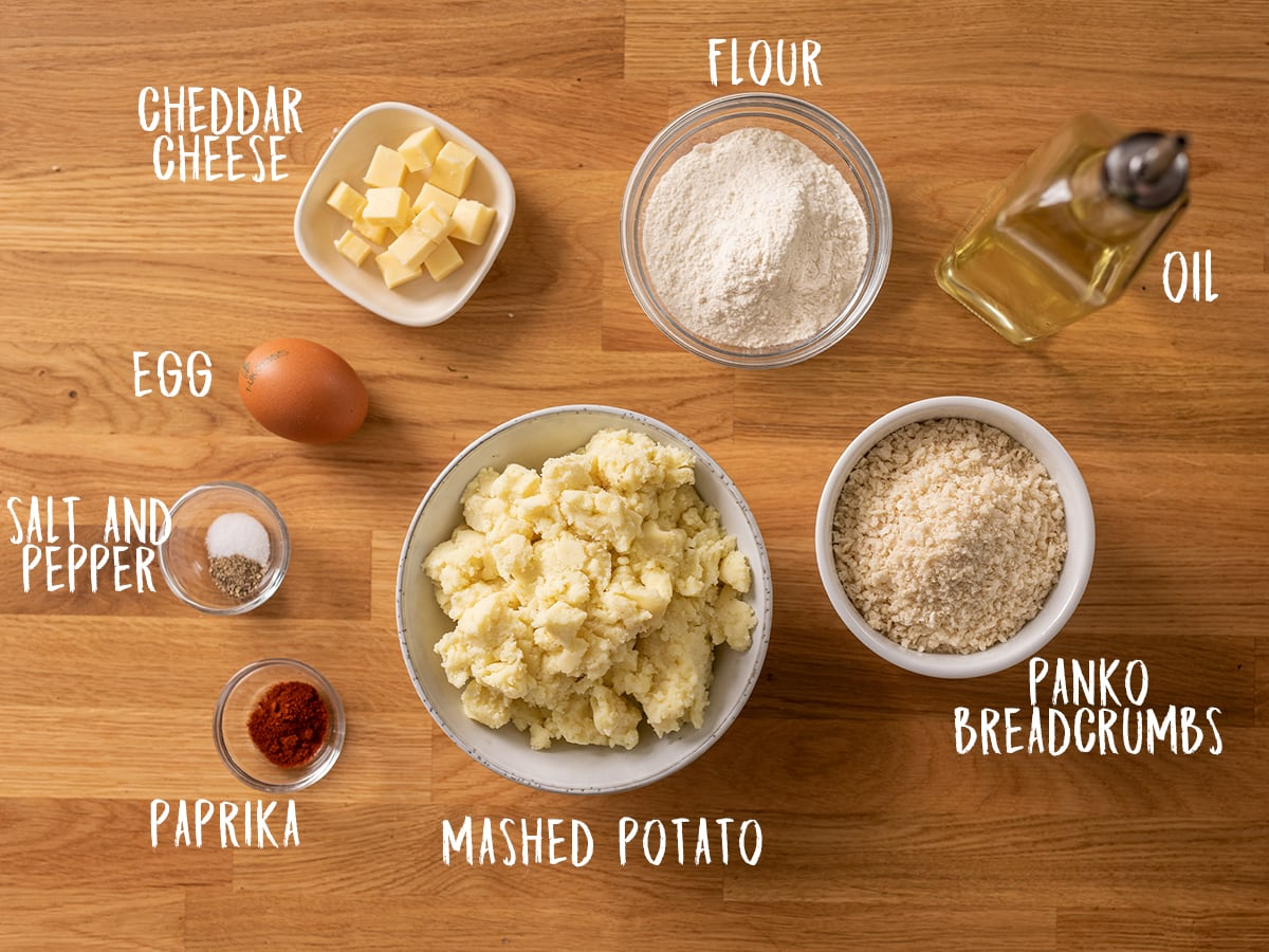 Ingredients for potato croquettes on a wooden table