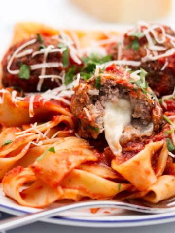 Tender meatballs stuffed with oozy mozzarella, served in a rich tomato sauce with pappardelle. Loved by kids and adults alike!