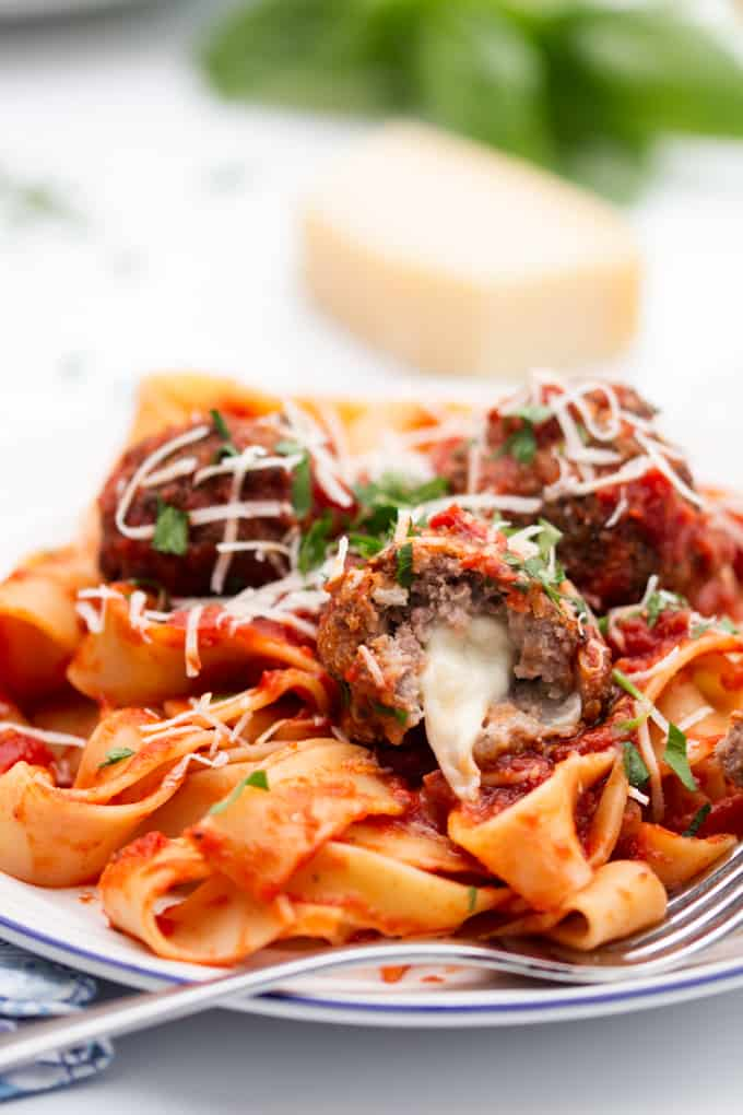 meatballs stuffed with oozy mozzarella with a rich tomato sauce and pappardelle pasta