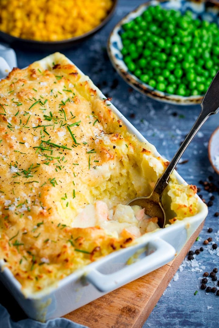 Spoonful being taken from fish pie