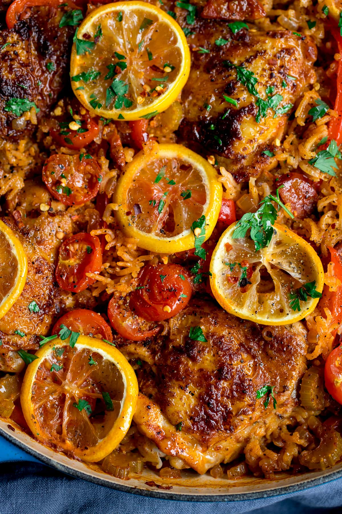 Spanish chicken and rice with lemon and tomatoes in a pan