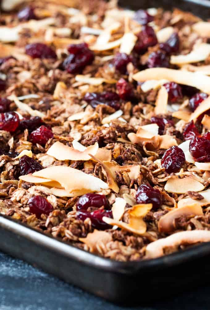 Chocolate coconut granola with cranberries in a baking tray