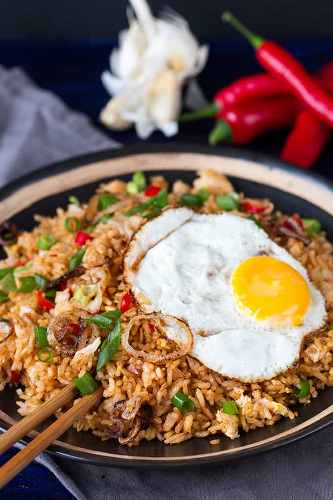 Bowl full of Indonesian fried rice topped with an egg