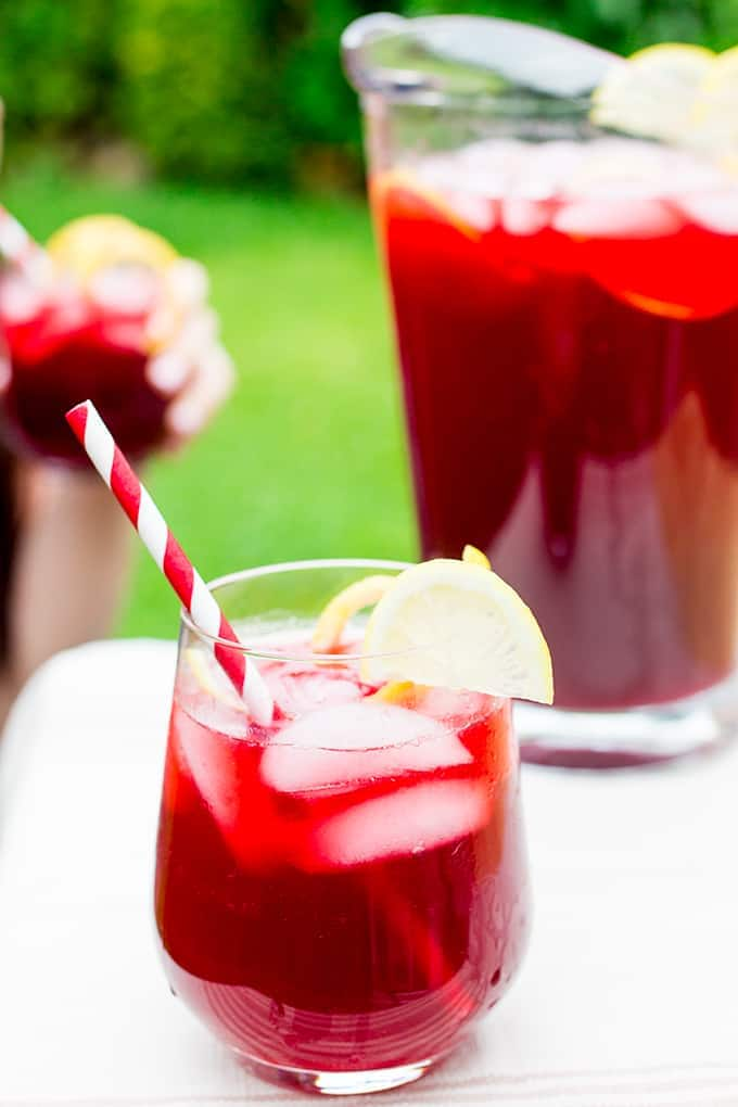 Spiced Berry Cooler - A punchy and refreshing non-alcoholic cocktail. Serve over ice for the perfect summer BBQ drink.