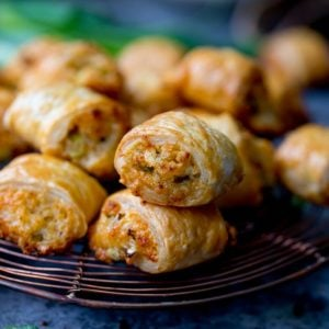Vegetarian sausage rolls piled up on a cooling rack