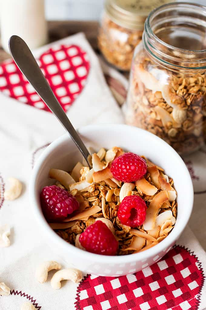 White Chocolate Coconut Cashew Granola in a bowl with a spoon