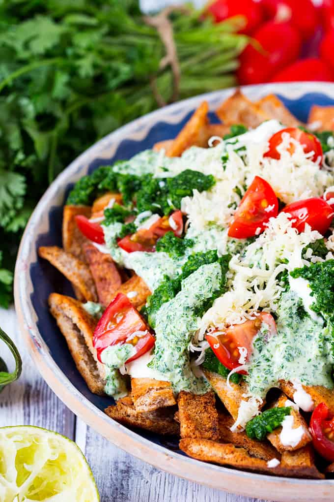 Homemade Healthy Nachos with Salsa Verde. Lot's of flavour and a touch of heat served on crunchy baked 'nachos'.