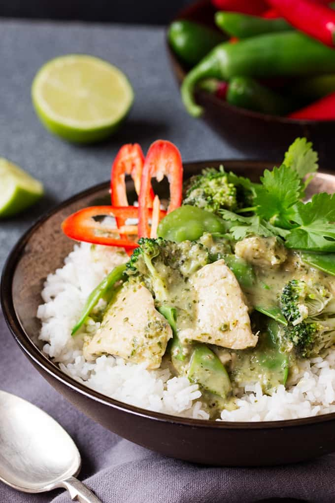 Skinny Thai Green Curry on a bed of rice in a bowl with chillis in the background