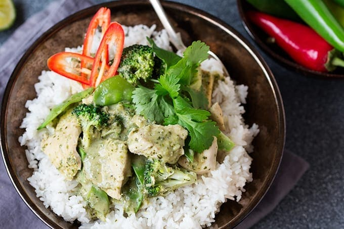 Bowl with rice and Thai Green Curry with sliced chillis